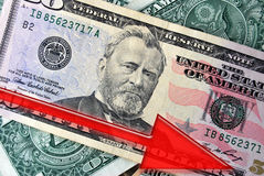 Dollar Falls. Red Arrow Decrease Down over American Dollars Stock Images
