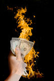 Dollar on fire. On black background Stock Photography
