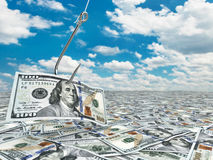 Dollar and fish-hook on cloudscape. Financial concept.. Stock Images