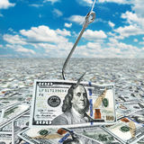 Dollar and fish-hook on cloudscape. Financial concept.. Stock Photos