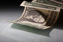 dollar floodlit pengar oss royaltyfri bild