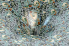 Dollar flow in finance hole Stock Images