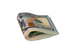 Dollar folded in half. On a white background royalty free stock image