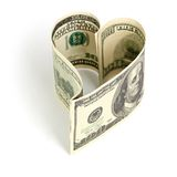 Dollar in form of heart Stock Images