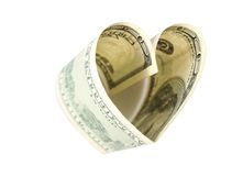 Dollar in form of heart. On white Royalty Free Stock Photos