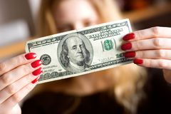 Dollar in front of face Royalty Free Stock Image