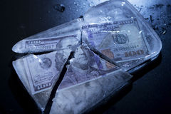 Dollar frozen. 100 Dollars frozen and cracked ice Royalty Free Stock Photography