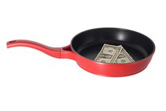 Dollar in frying pan Stock Photo