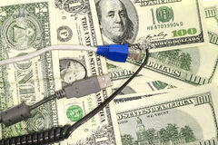 Dollar and Gadgets Stock Image