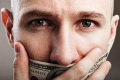 Dollar gag shut voiceless man. Human silence - dollar gag shut voiceless man Royalty Free Stock Image