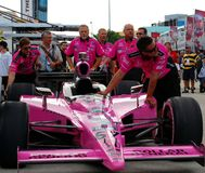 Dollar General Indy Car. Pink Dollar General Car and Crew at the IZOD IndyCar Championship Series Royalty Free Stock Photography