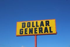 Dollar General Sign Against a Blue Sky royalty free stock photography
