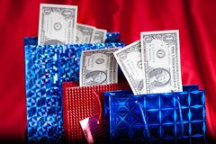 Dollar gift on red background Royalty Free Stock Image