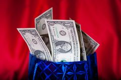 Dollar gift on red background Royalty Free Stock Images