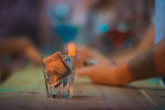 Dollar in glass Stock Images