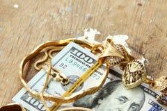 Dollar with gold Stock Photos