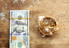 Dollar bills or money with gold Royalty Free Stock Image