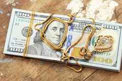 Dollar bills or money with gold Stock Photos