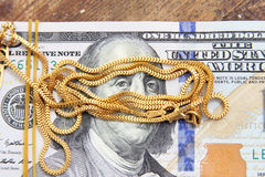 Dollar with gold Royalty Free Stock Photos