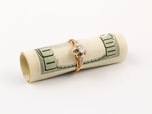 Dollar and golden ring Royalty Free Stock Images
