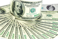 Dollar hög som bakgrund Arkivfoto