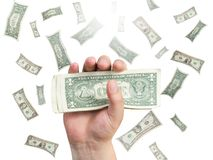 Dollar in hand over falling money background Royalty Free Stock Image