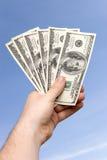 dollar handholdingman s Royaltyfri Foto
