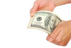 Dollarbanknotengeld in der Hand Stockfoto