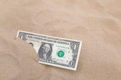 Dollar in het horizontale zand. Royalty-vrije Stock Afbeelding