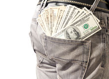 Dollar in his back pocket blue jeans. Young man extracting dollar from his blue jeans Royalty Free Stock Image