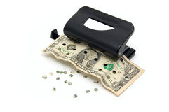 Dollar in the hole punch Stock Images