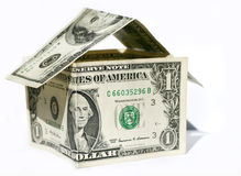 Dollar home. House made of us dollars Royalty Free Stock Images