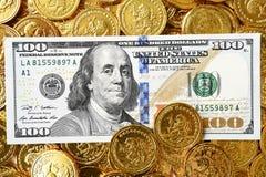 Dollar honderd en muntstukken Stock Afbeelding