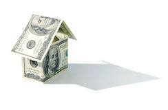 Dollar house. House made from dollars with a shadow Stock Image