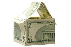 Dollar House. House made of Dollars isolated on white Stock Photo
