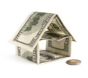 Dollar House. Little house made of dollars on a white background stock photography