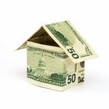 Dollar house. A house made from dollar bills Royalty Free Stock Photos