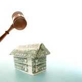 Dollar house and gavel. Origami house made out of dollar bills gavel Stock Photos
