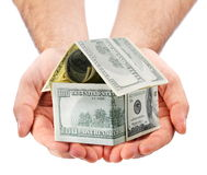 Dollar house on the hands Royalty Free Stock Image