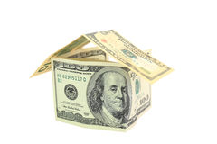Dollar house isolated over white. Royalty Free Stock Photo