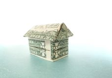 Dollar house. Origami house made out of dollar bills Stock Photo