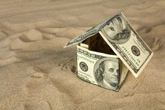 Dollar house on sand. Royalty Free Stock Images