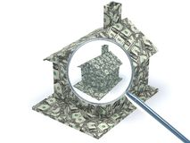 Dollar House under magnifying glass Stock Photos