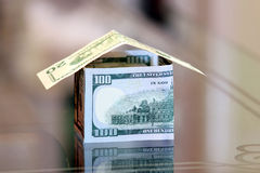 Dollar bills money house Royalty Free Stock Photos