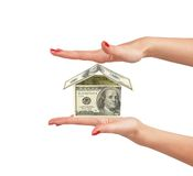 Dollar house on woman hand isolated on white Stock Images