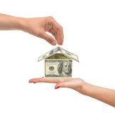 Dollar house on woman hand isolated on white Stock Photos