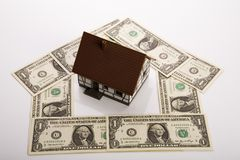Dollar and Houses Stock Photos