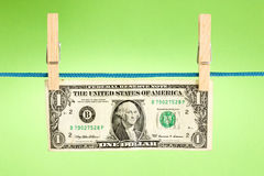 Dollar hung  over a green background Stock Images
