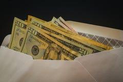 Dollar i det vita säkerhetskuvertet Royaltyfria Foton