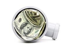 Dollar i en plast- leda i rör isolerat på vit Arkivfoton